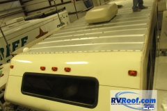 FlexArmor-lifetime-sprayed-rv-roof-alternative-being-applied-to-metal-roof