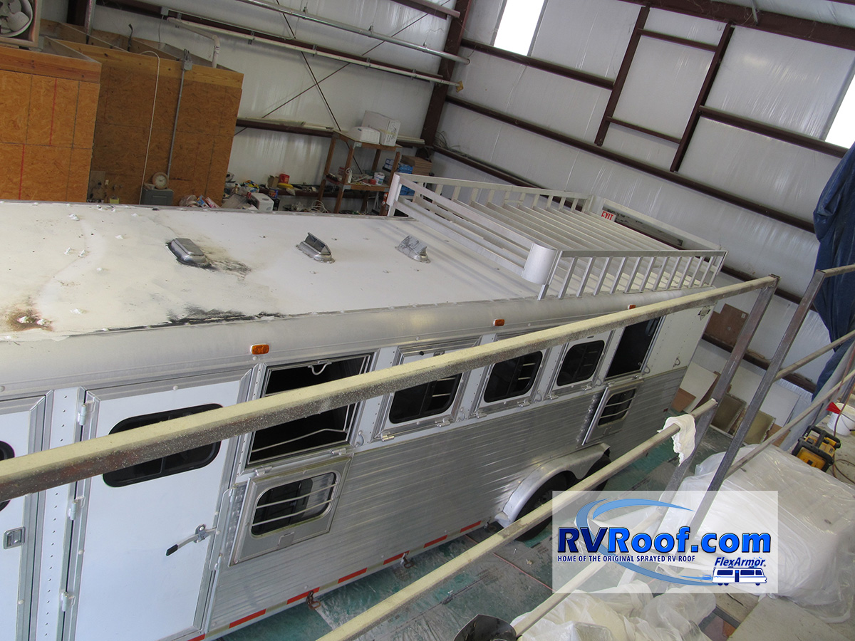 Horse trailer in shop getting ready for lifetime no leak sprayed roof