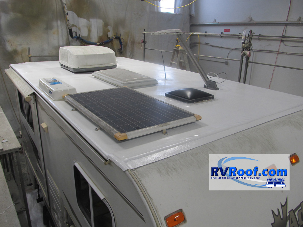 Truck camper with solar panels and FlexArmor rv roof applied