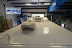 Rear view of Excel fifth wheel with FlexArmor sprayed rv roof