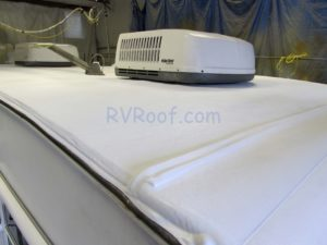Top and edge of a RV Roof with FlexArmor applied shows thickness and durability