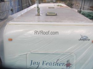 preparing a camper roof for repair and application of FlexArmor sprayed on rv roof