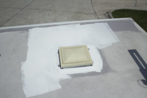 liquid rolled on rv roof prep and application around a vent